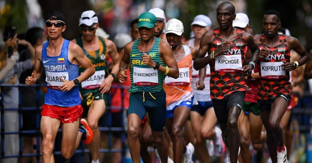 Runners, from left, Jeison Alexander Suarez of Colombia, Daniel Do Nascimento of Brazil, Eliud Kipchoge of Kenya, and Amos Kipruto of Kenya during the men's marathon at Sapporo Odori Park. (Photo By Ramsey Cardy/Sportsfile via Getty Images)