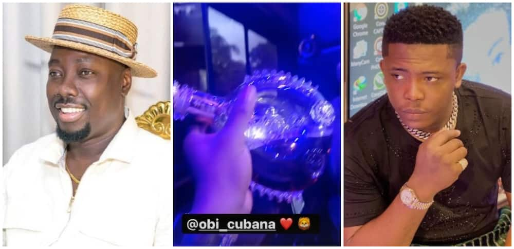 Photos of Obi Cubana and jeweller ObisGallery with a bottle of cognac.