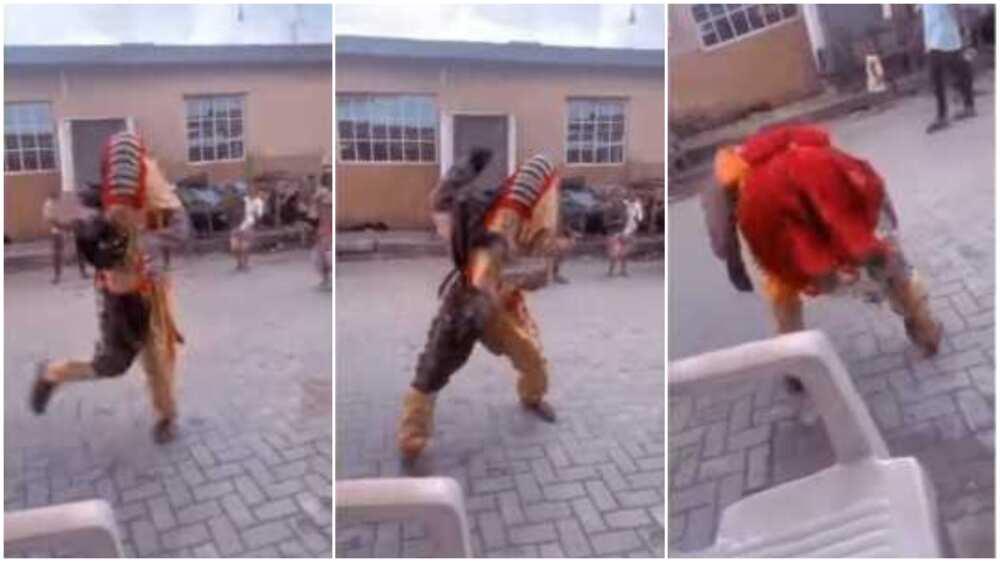 A Nigerian masquerade did creative legwork moves.