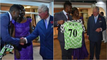 Former Super Eagles captain Joseph Yobo presents Prince Charles a Nigerian jersey