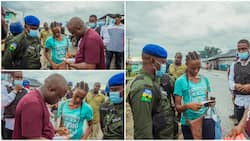 Kind Nigerian man surprises lady with N500k for her calmness after his car mistakenly splashed water on her