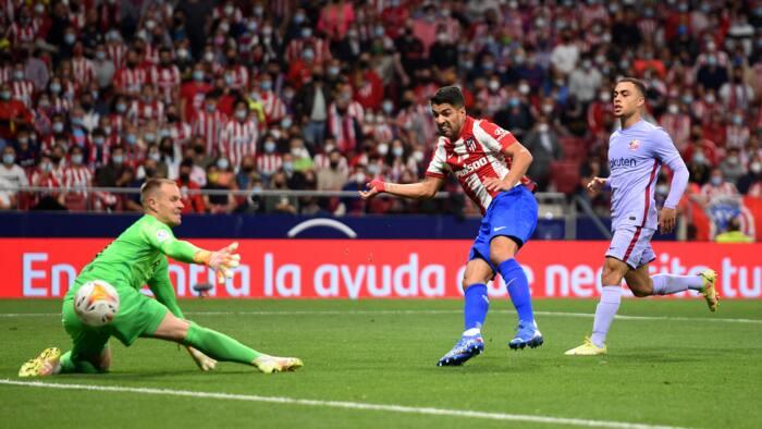 Luis Suarez scores as Atletico Madrid punish Barcelona in Spanish La Liga battle
