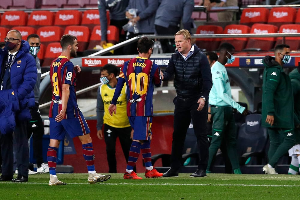 Lionel Messi and Koeman in action for Barcelona