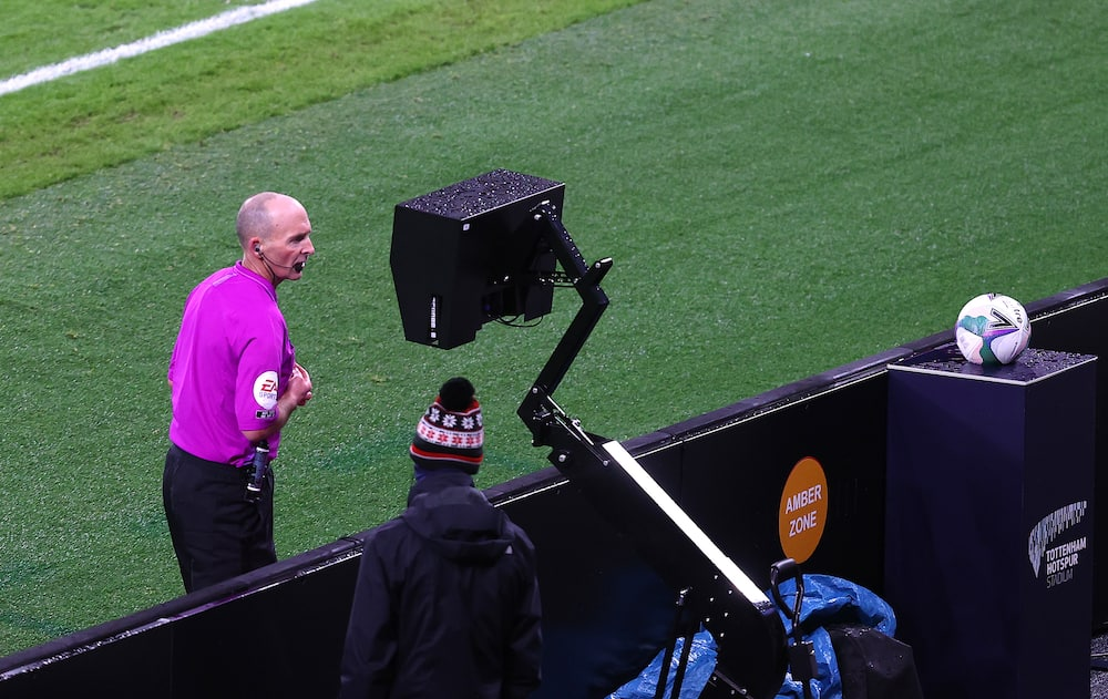 Mike Dean in action in the Premier League.
