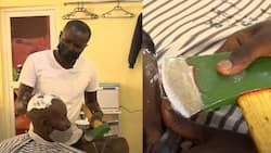 Talented barber who shaves people's hairs with axe goes viral, he charges N1800 per haircut