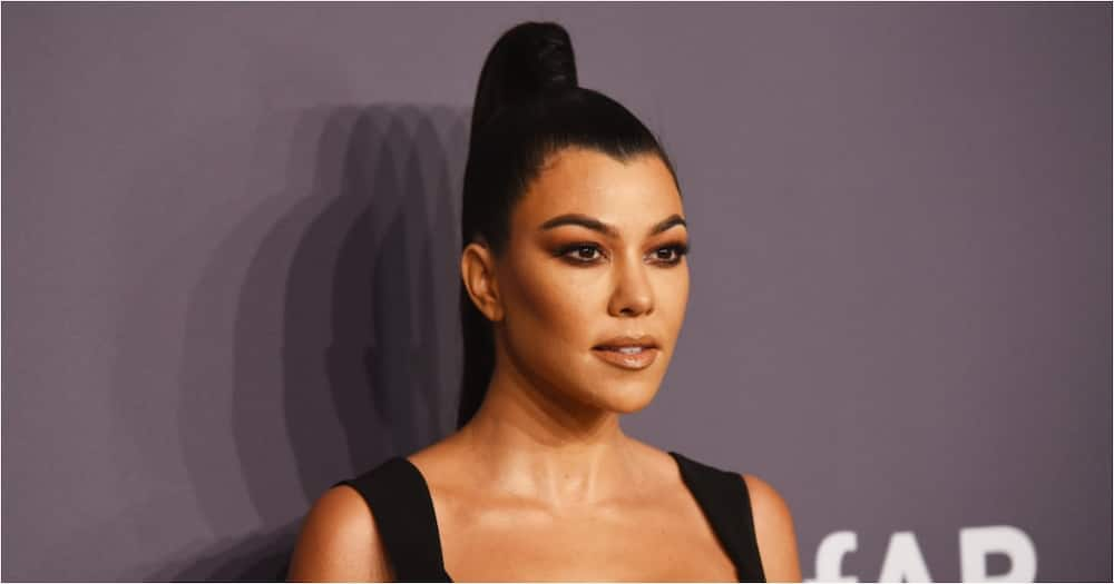 Kourtney Kardashian's bikini pics have fans thinking she's pregnant