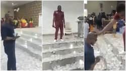 """Man """"chokes"""" his pastor with money as he sprays him hard currency on the altar in viral video"""