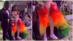 Wedding fashion: Beautiful bride stuns in rainbow-coloured reception dress