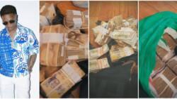 Wizkid Flaunts 2 Big Sacks of Naira and Dollar in His Lagos Hotel Room