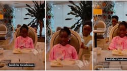Little gentleman: Tiwa Savage's son Jamil pulls out chair for Imade as they dine at fancy restaurant