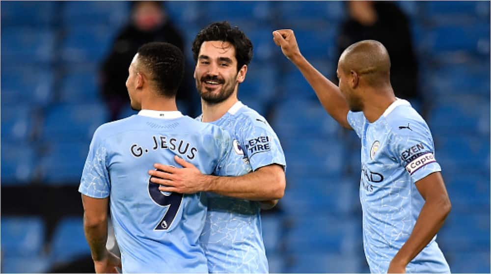 See hilarious moment Man City star stopped teammates from hugging in goal celebration as he's called Covid officer (video)