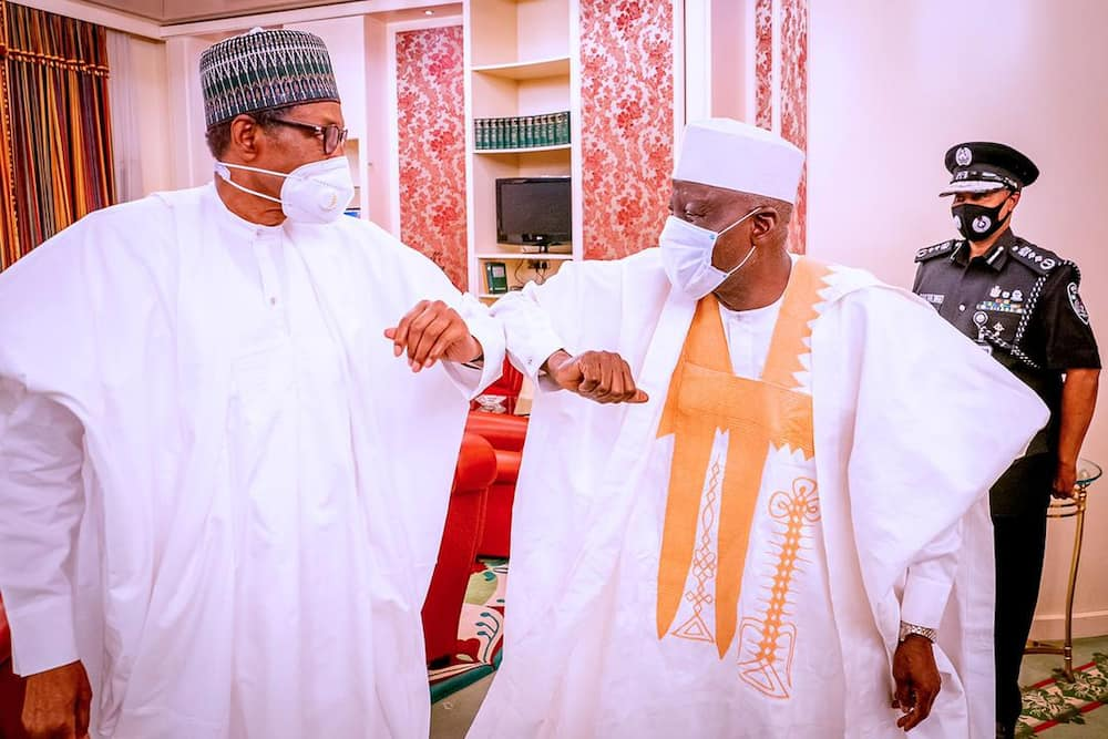 Police minister presents new IGP Baba to President Buhari