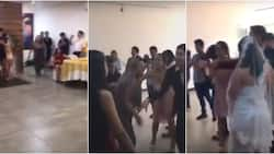 Jealous woman crashes wedding to say 'I love you' to groom and slap the bride (video, photos)