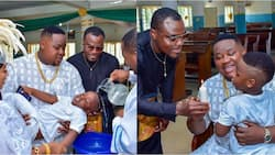 Rich Super Eagles star stunned as Cubana Chiefpriest's son gets baptised in all-white D&G designer wear
