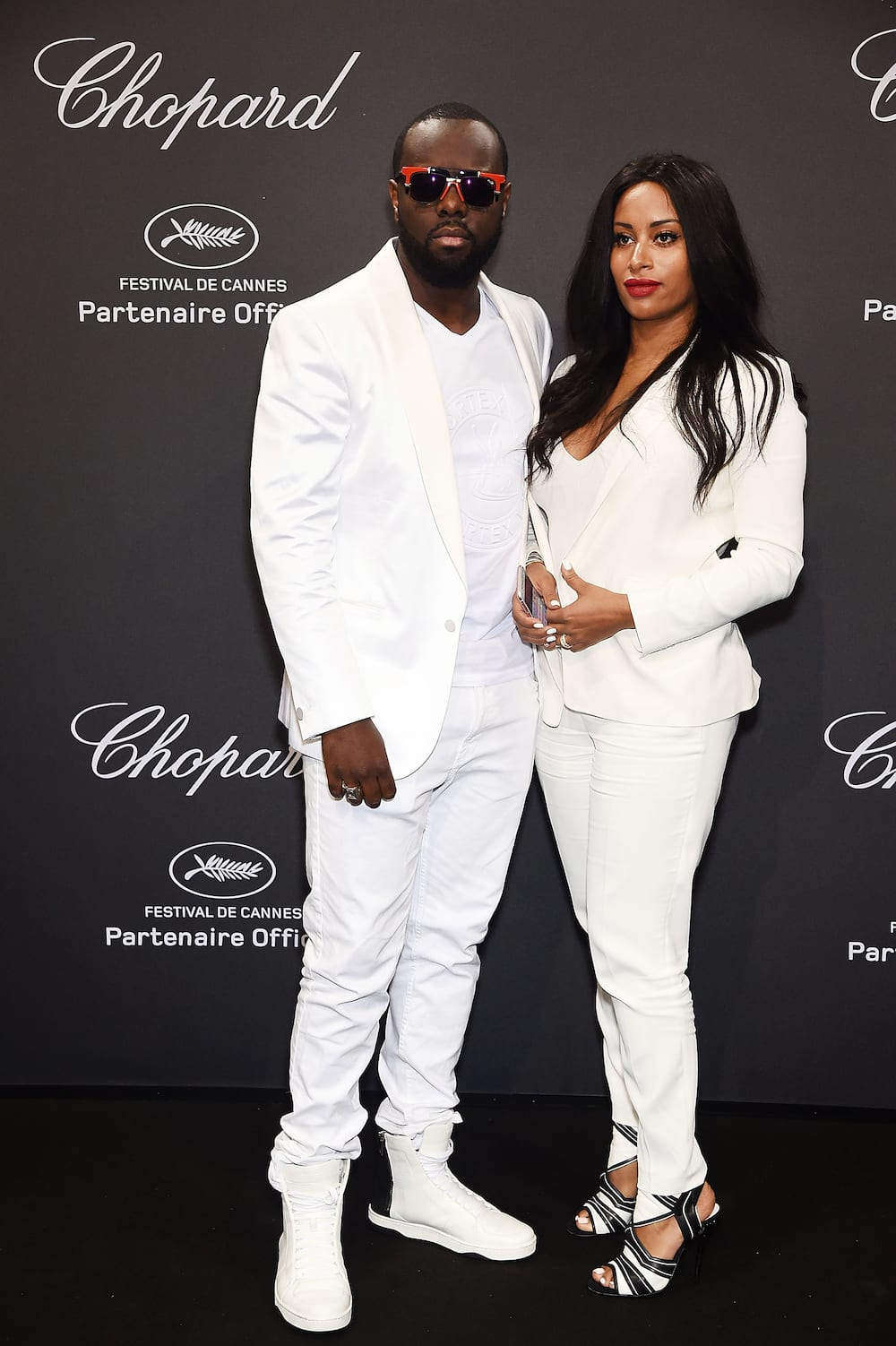 Maître Gims et son épouse DemDem assistent à la soirée Chopard au 69e Festival de Cannes le 16 mai 2016 à Cannes, France. (Photo par Stéphane Cardinale - Corbis/Corbis via Getty Images)