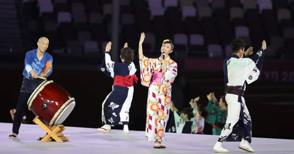 A singer during the Closing Ceremony on day sixteen of the Tokyo 2020 Olympic Games at Olympic Stadium on August 8, 2021 in Tokyo, Japan. (Photo by Jean Catuffe/Getty Images).