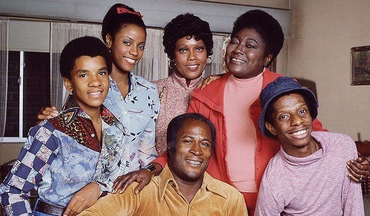 How old is John Amos?