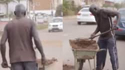 Poor 63-year-old man fills potholes in his community after selling coconuts to get money, says he's helping the govt (video)