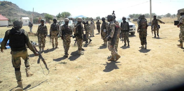 Image result for Armed Soldiers Shut Down DailyTrust Office, Arrest Reporters