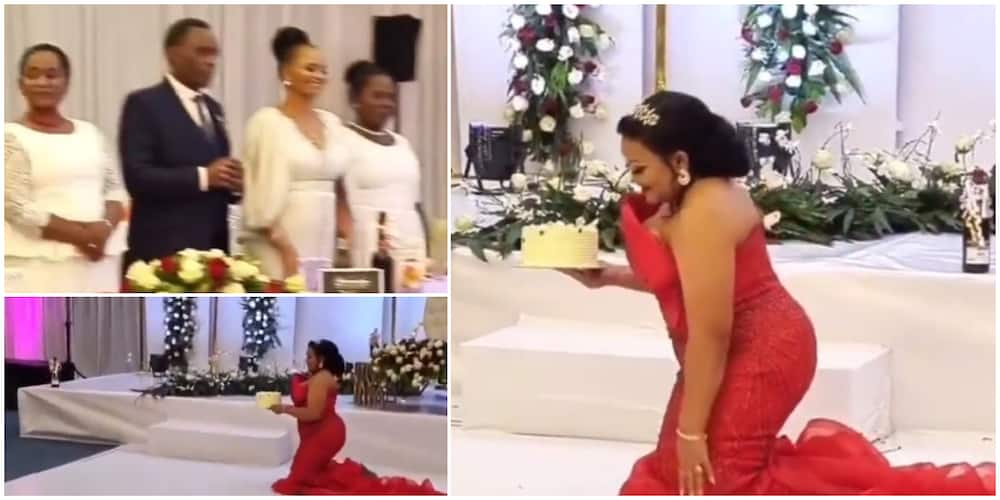 Reactions as 'bride' is made to knee-walk with cake in hand at wedding in trending video
