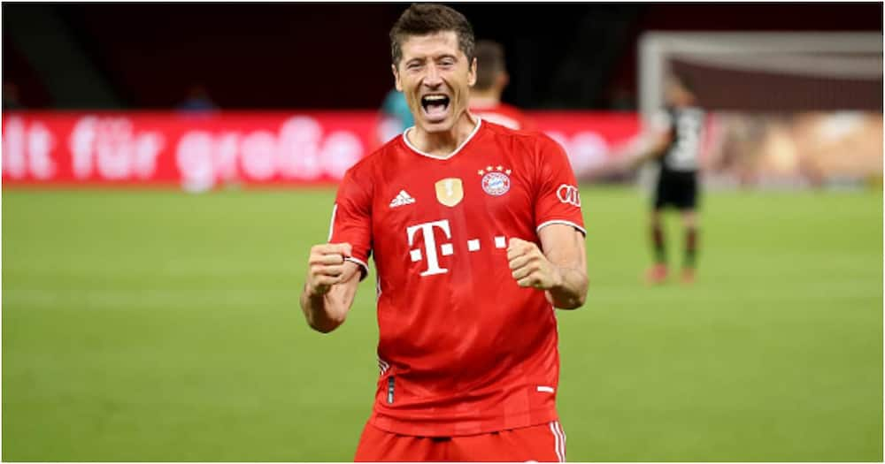 Robert Lewandowski celebrates scoring during the DFB Cup final match between Leverkusen and Bayern Muenchen in Berlin, Germany. Photo by Alexander Hassenstein/Getty Images.