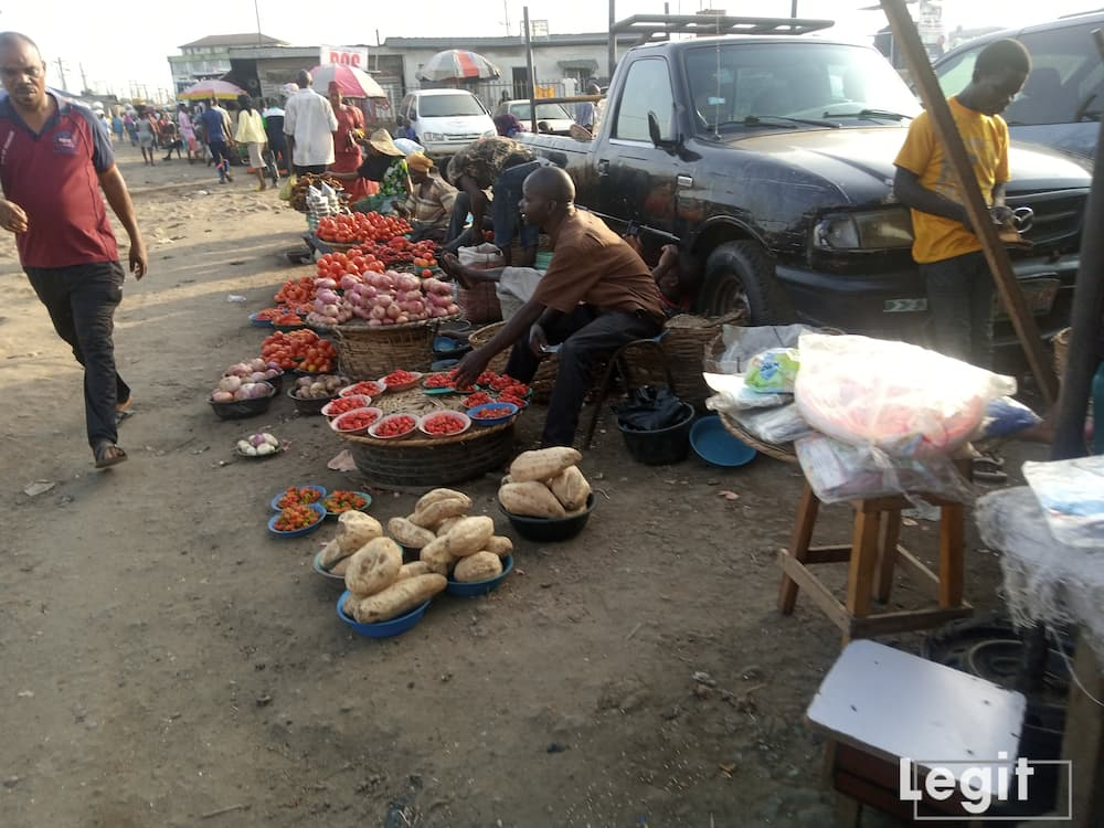 Perishable dealers at the market decry poor sales despite the affordability of goods like onion and tomatoes. Photo credit: Esther Odili
