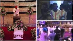 """Lady """"prophesies"""" powerfully during TB Joshua's burial in viral video, officials take her out of the church"""