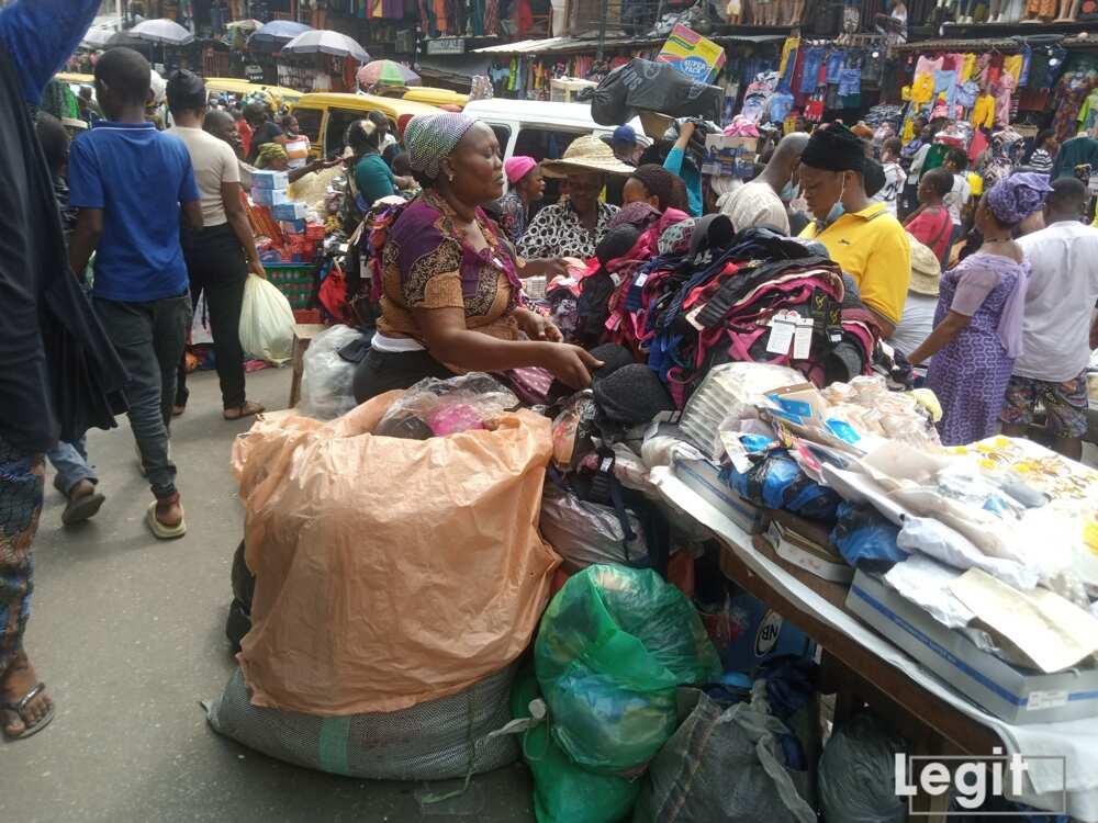 A pant and bra seller attending to a buyer at Balogun market, Balogun, Lagos. Photo credit: Esther Odili