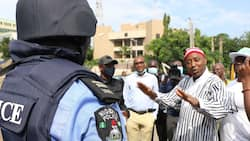 Updated: Hoodlums storm Nnamdi Kanu's trial, beat up Sowore, photo emerges