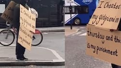 Man wears placard with his sin written on it in public after cheating on girlfriend