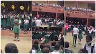 Secondary school students show love, boy kneels for girl in viral video as they hug, Nigerians react