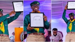 Best artist in UAR: Sanwo-Olu excited as he finally receives his funny-looking portrait from artist