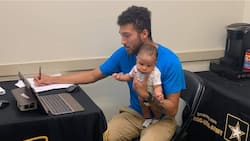 Dad goes viral after taking 3-month-old son along to army recruitment exam, writes test as he holds him