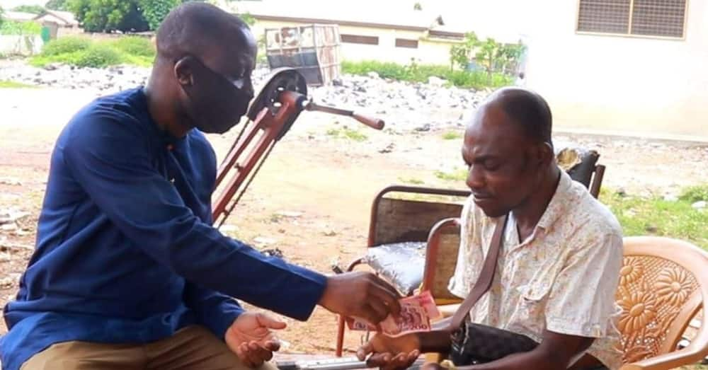 Physically challenged call credit seller's hands shake as he is surprised with GHC2,000