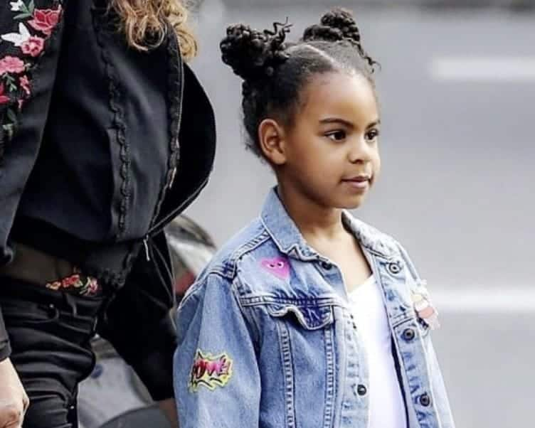 Jay-Z's daughter Blue Ivy pictured sipping a drink from her first Grammy