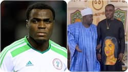 Super Eagles legend customises wife's picture on his cloth as he meets influential traditional Nigerian ruler