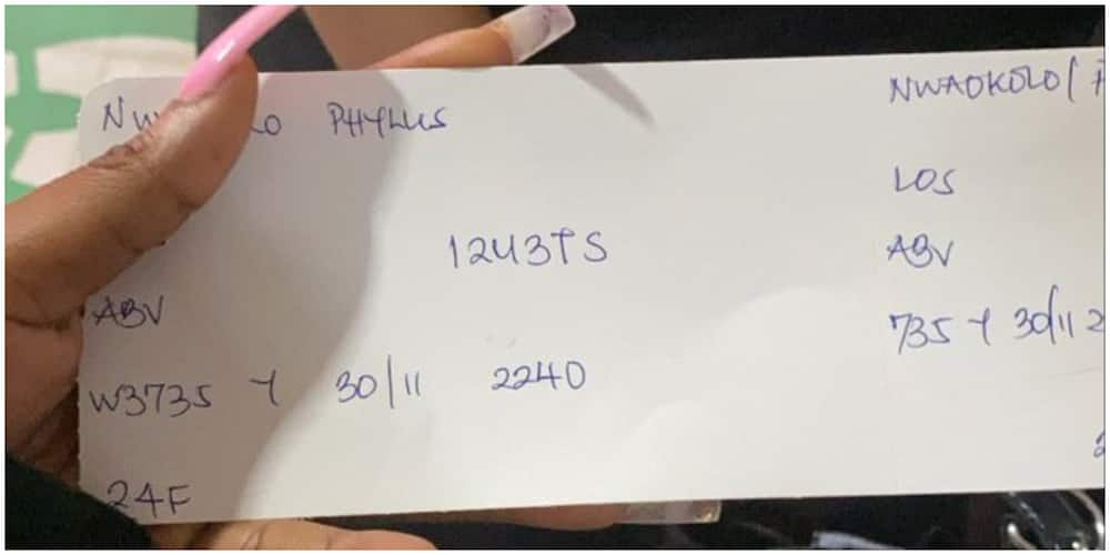 Mixed reactions as lady shares handwritten boarding pass issued to her by Nigerian airline