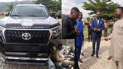 Photo shows moment Winners Chapel pastor received N55m Land Cruiser Prado as gift from church member