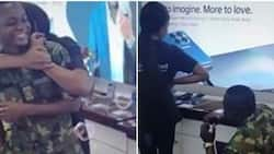 Sweet moment Nigerian soldier proposes marriage to girlfriend at her workplace, melts hearts on social media