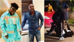 Video of actor Odunlade Adekola fighting singer Teni on movie set