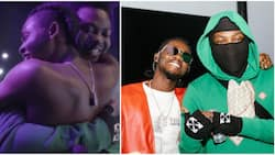 Heartwarming moment Omah Lay jumped on Olamide on stage, kneels to pay homage to senior colleague