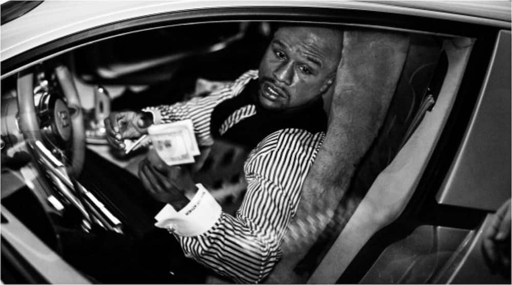 Inside Floyd Mayweather's amazing £20m car collection with white vehicles in Las Vegas and same motors in black in LA