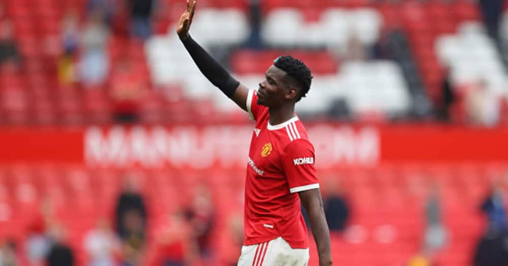 Paul Pogba acknowledges the fans following victory in the Premier League match between Man United and Leeds United at Old Trafford on August 14, 2021 in Manchester, England. (Photo by Catherine Ivill/Getty Images,)