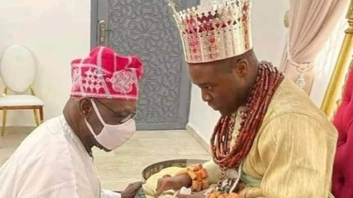Photo emerges as Obasanjo ignores age difference, goes on his knees to pay homage to new Olu of Warri
