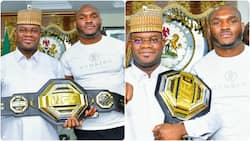 Nigeria's UFC champion Kamaru Usman presents his belt to Kogi state governor Yahaya Bello