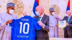 President Buhari receives customized shirt from FIFA president Gianni Infantino