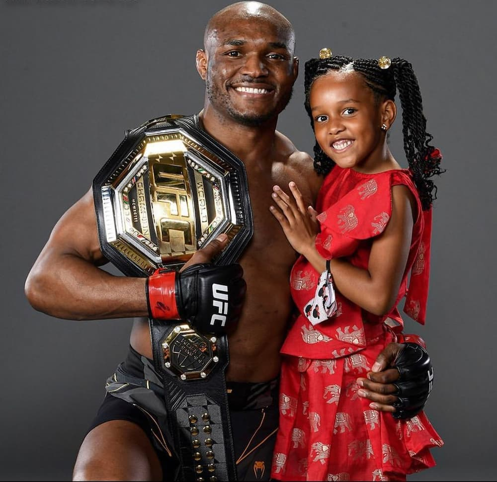 UFC champion Kamaru Usman trains with his 6-year-old daughter