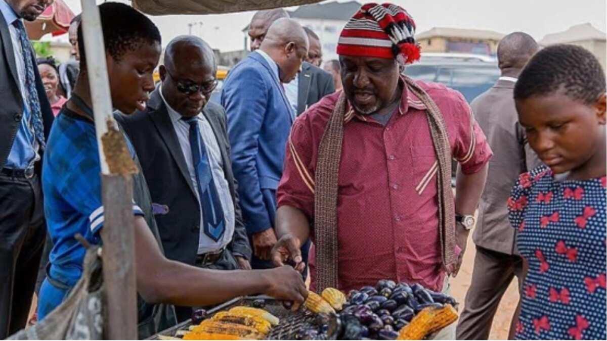 Fayose buys 'ponmo', Atiku drinks 'pure water', Ortom eats akara - How Nigerian politicians desperately woo voters (photos)
