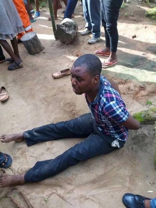 Angry youths tortures for allegedly beating his mother to death (photos)