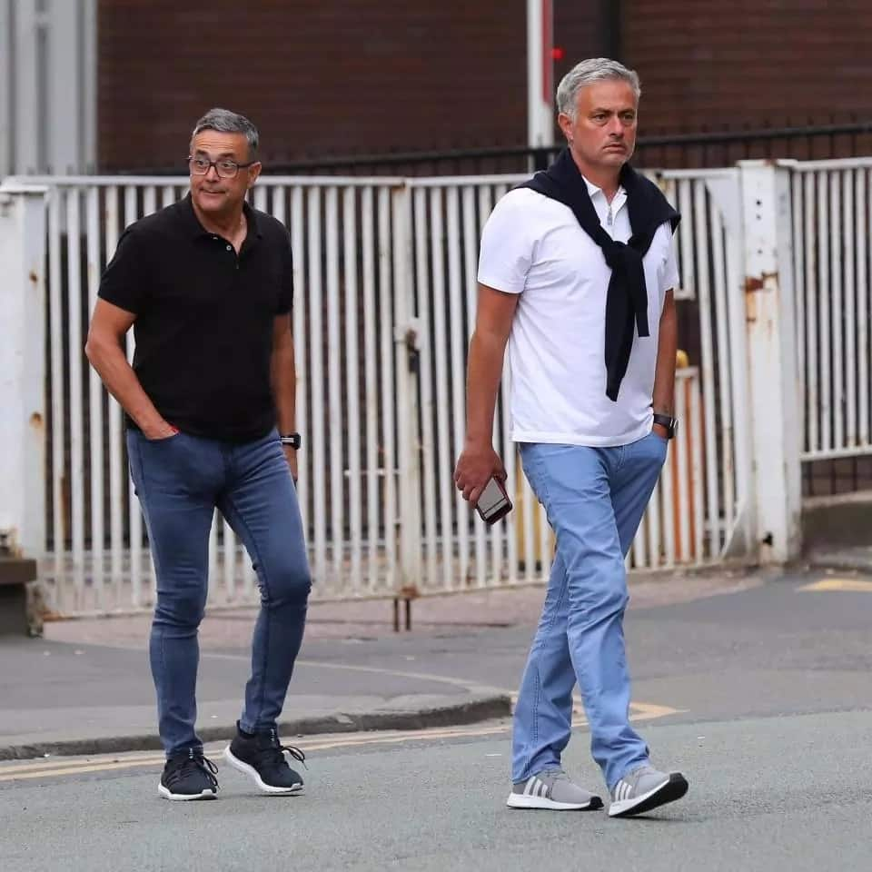 Mourinho looks glum as he heads out for food in Manchester